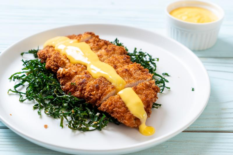Fried chicken with lemon lime sauce. Fried chicken breast with lemon lime sauce stock photo