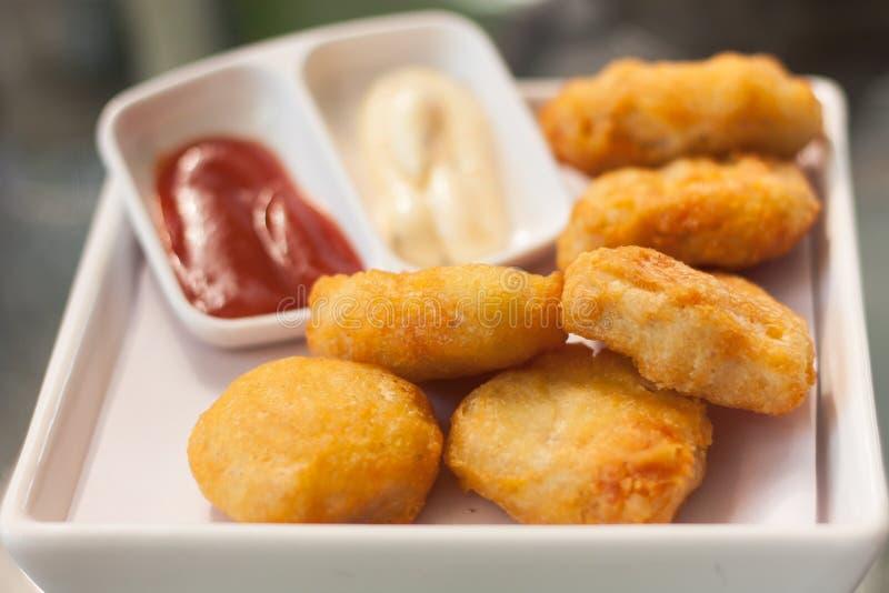 Fried Chicken-Nuggets stockbild