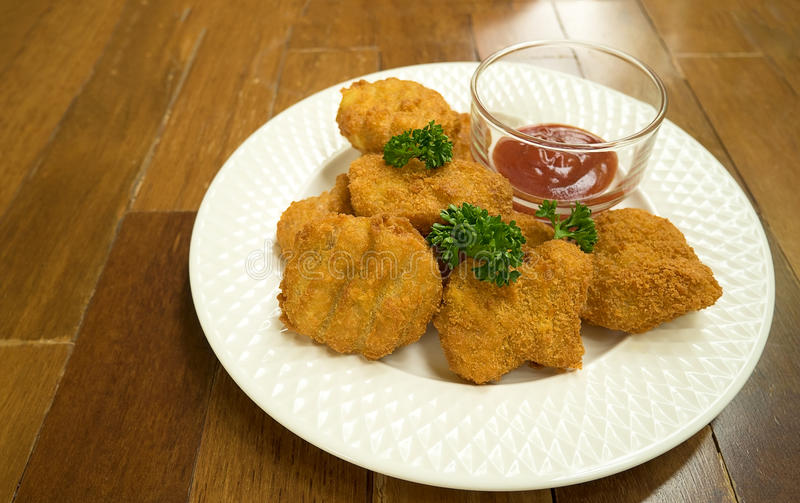 Fried chicken nuggets on wood table stock image