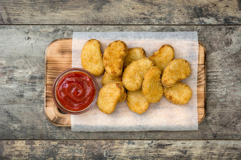 Fried chicken nuggets on wood royalty free stock image