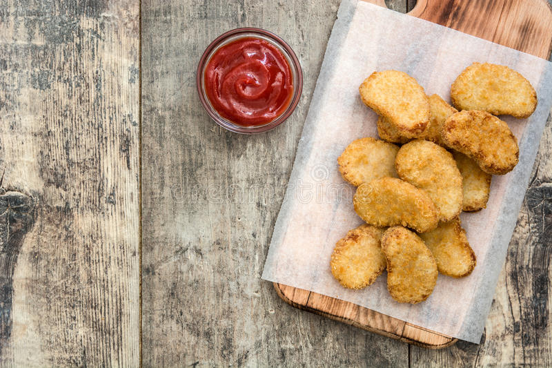 Fried chicken nuggets on wood royalty free stock photos