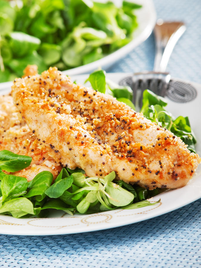 Fried chicken with salad. One portion on the table royalty free stock images