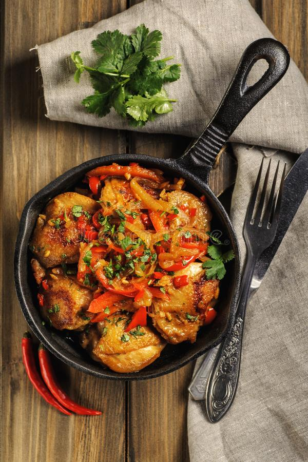 Fried chicken in spicy sauce with vegetables. royalty free stock photo