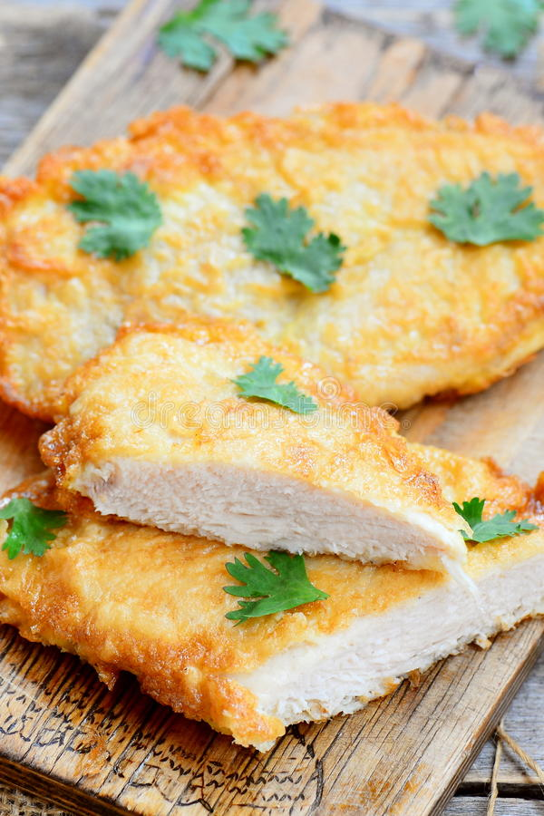 Fried chicken steaks in egg batter homemade chicken steaks on a download fried chicken steaks in egg batter homemade chicken steaks on a wooden board forumfinder Image collections