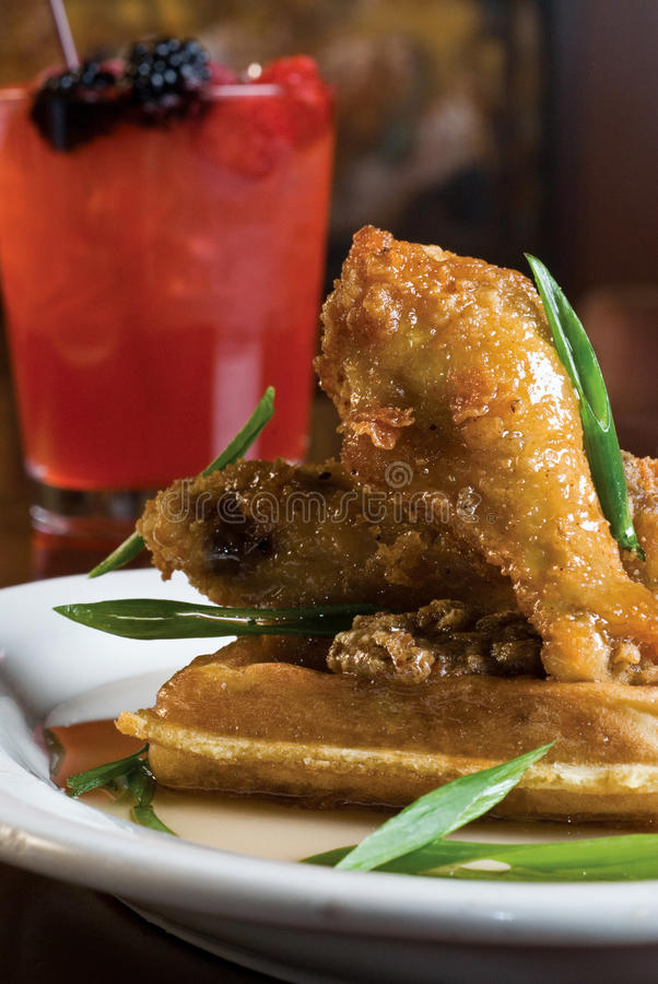 Fried chicken and waffles. With a berry mixed drink royalty free stock photos