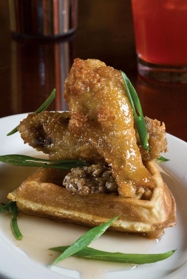 Fried chicken and waffles. With a berry mixed drink stock image