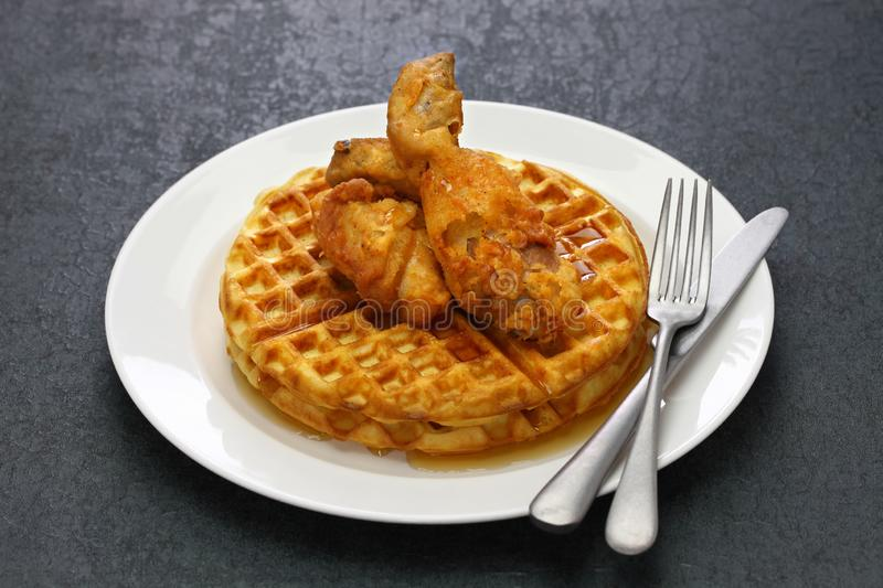 Fried chicken and waffles. American food stock images