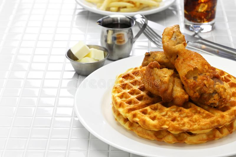 Fried chicken and waffles. American food royalty free stock photography