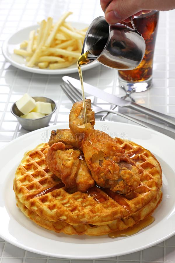 Fried chicken and waffles with maple syrup. American food stock photography