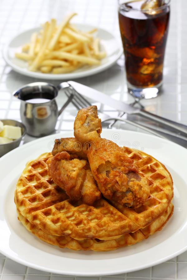 Fried chicken and waffles with maple syrup. American food royalty free stock image