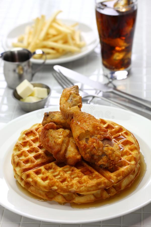 Fried chicken and waffles with maple syrup. American food stock photo