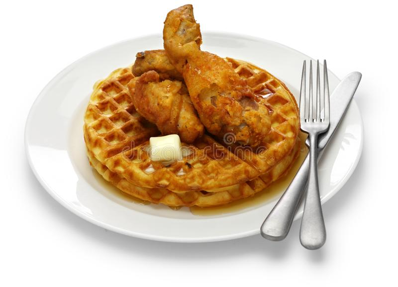 Fried chicken and waffles with maple syrup. American food stock images