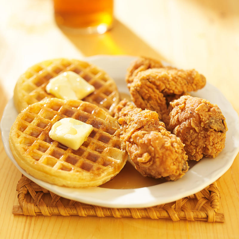Fried chicken and waffles meal. Shot close up stock photography