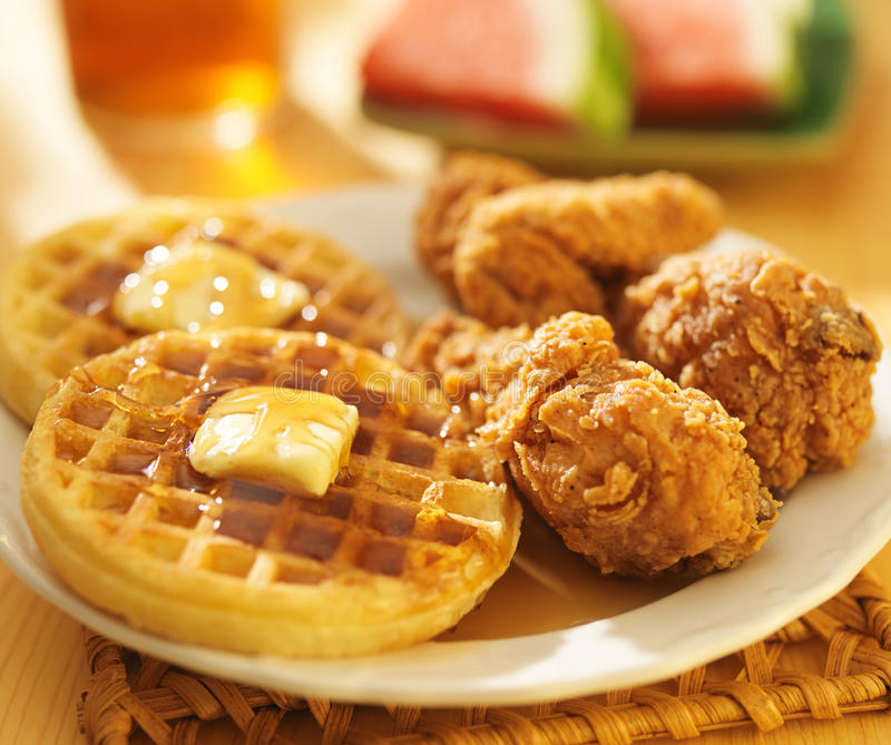 Fried chicken and waffles with watermelon. Shot close up stock photo