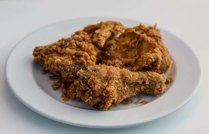 Fried chicken on white plate on white background. stock photos