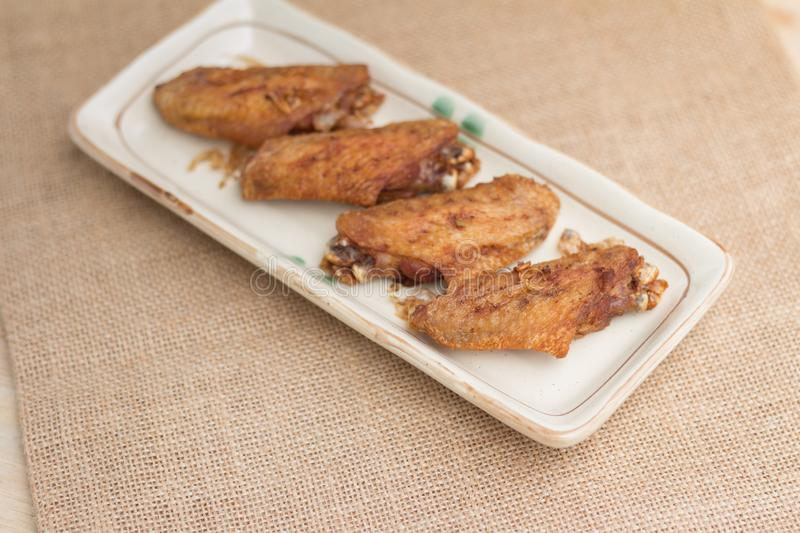 Fried chicken wings and crispy garlic with Thai food style stock photo