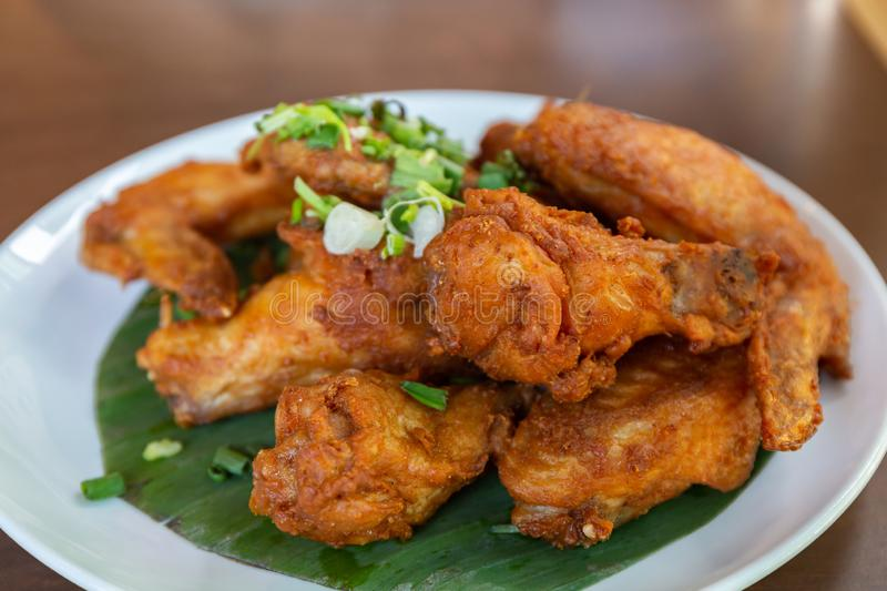 Fried Chicken Wings with Fish Sauce stock photos