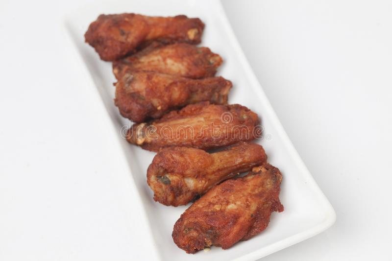 Fried Chicken Wings with sesame. Isolated on white background royalty free stock photos