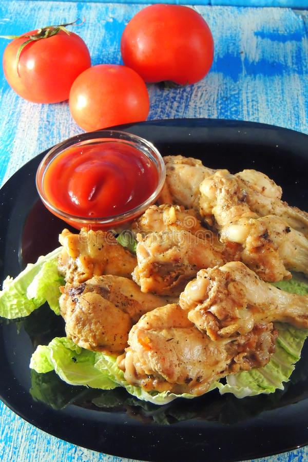 Fried wings with sauce stock photos