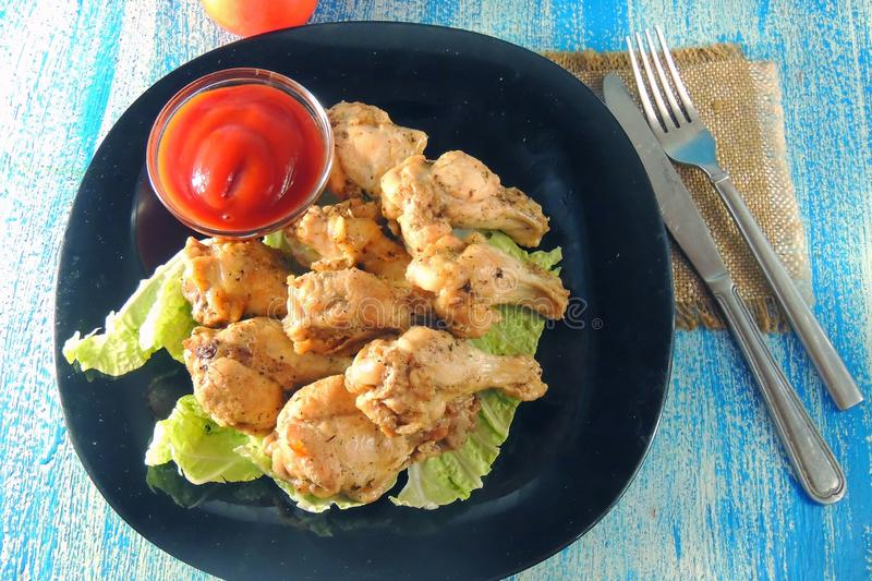 Fried wings with sauce royalty free stock photography