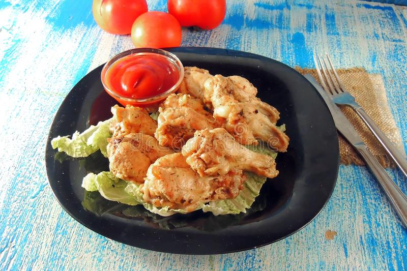 Fried wings with sauce royalty free stock images