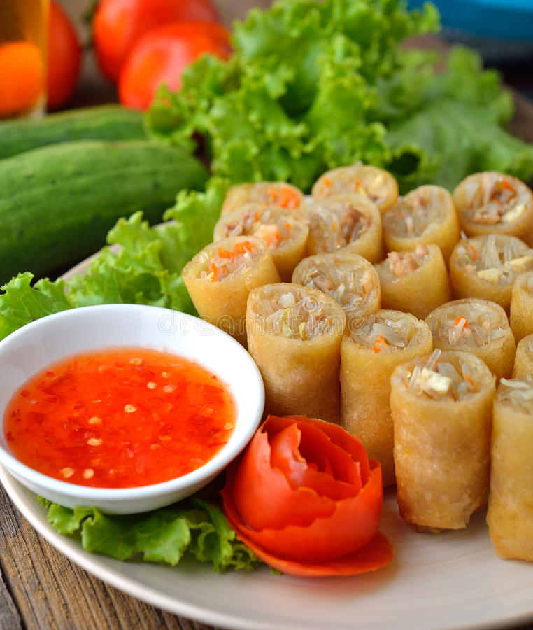 Fried Chinese Traditional Spring rolls food. On white plate royalty free stock images