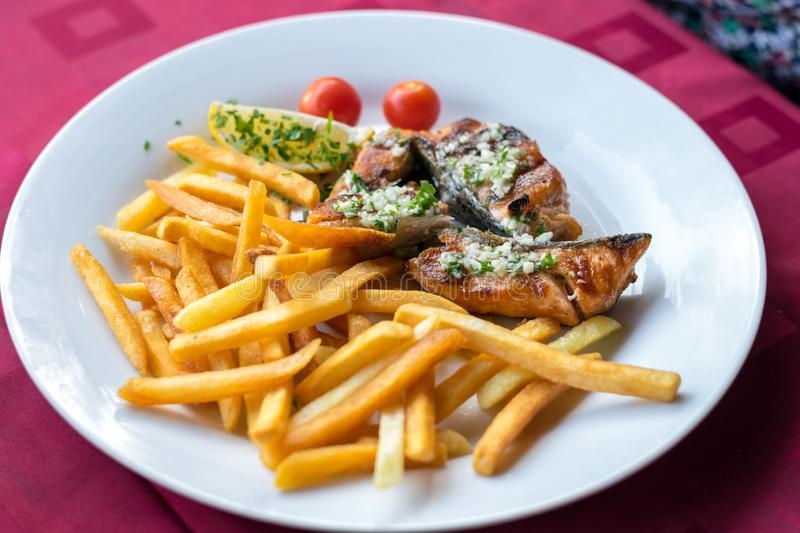Fried cod fillet with French fries stock image