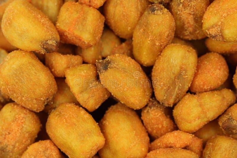 Fried crispy corn grain background royalty free stock photos