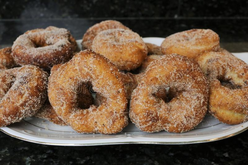 Fried donuts with sugar a typical sweet in Easter and Lent. The fried donuts with sugar are a typical sweet in Easter and Lent in Andalusia and Spain. The donuts royalty free stock photo