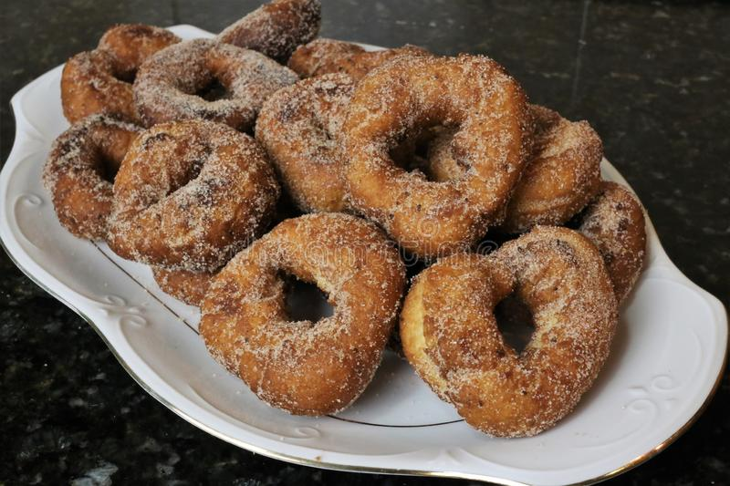 Fried donuts with sugar a typical sweet in Easter and Lent royalty free stock photo