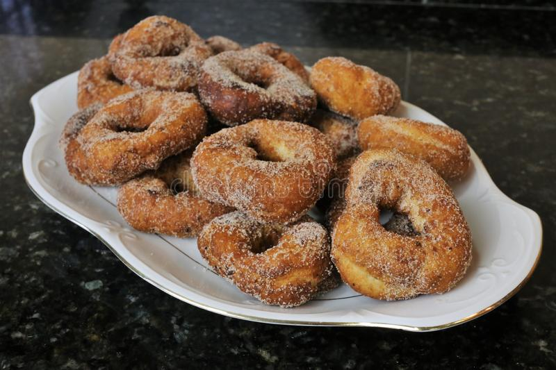 Fried donuts with sugar a typical sweet in Easter and Lent stock photos