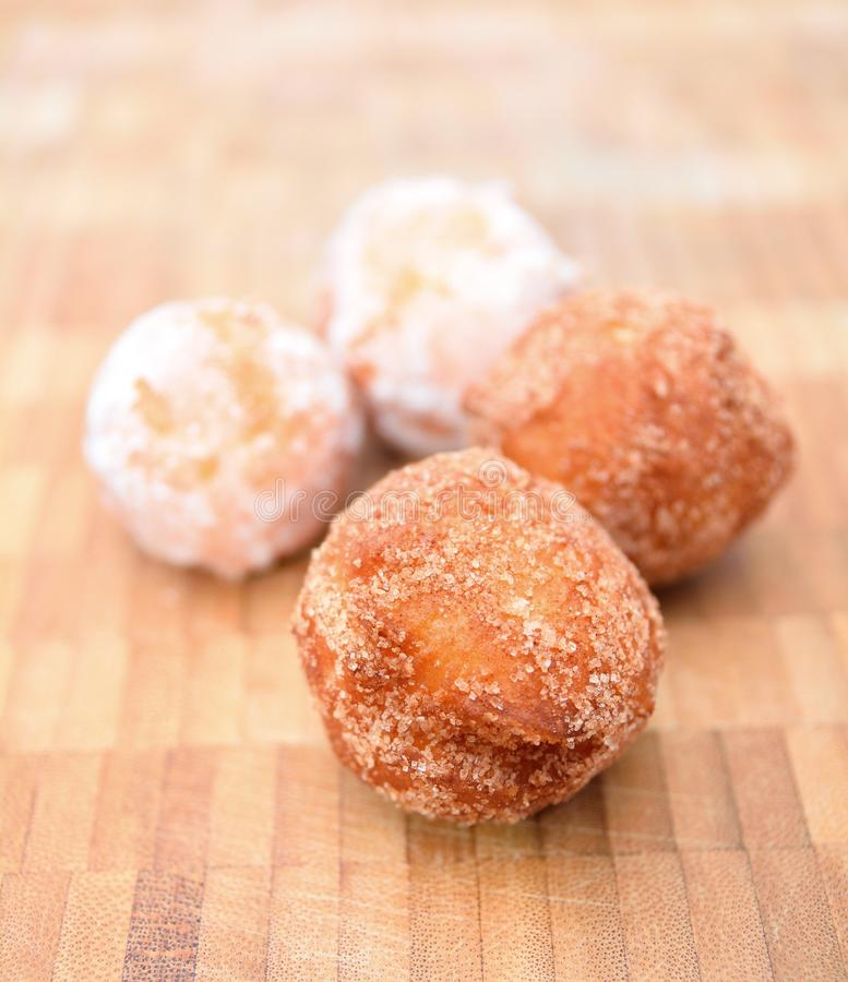 Fried donuts on a wooden plate. royalty free stock photo