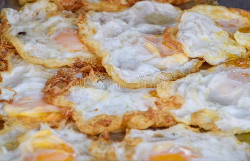 Fried egg Arranged on tray. Many fried eggs are arranged in shop, Delicious and cheap food, Protien from egg. Appetizing, background, breakfast, cook, cooked stock image