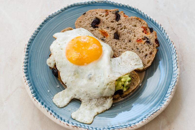 Fried Egg with Avocado on Toast Bread for Breakfast royalty free stock photo