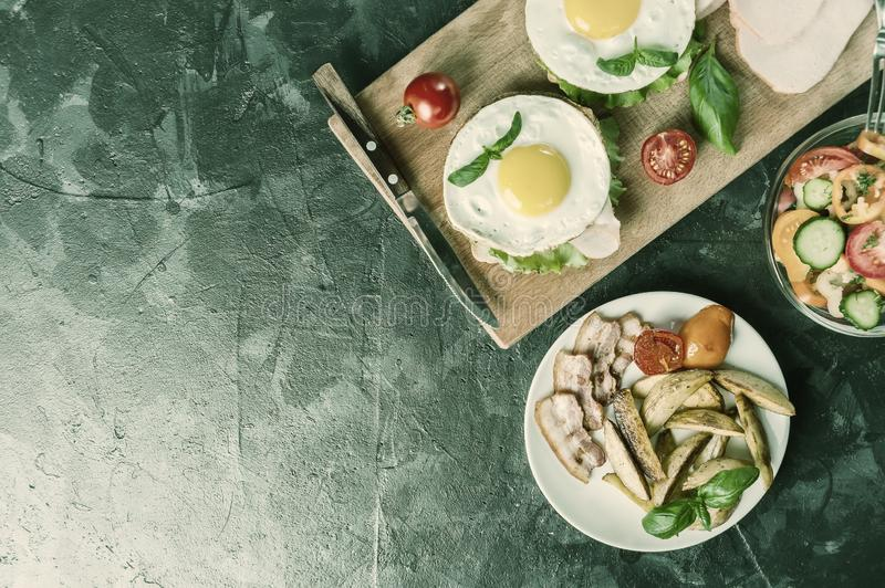 Fried egg and bacon. On plate, coffee on wooden rustic table, flat lay. Vintage stylization, retro film filter stock photography
