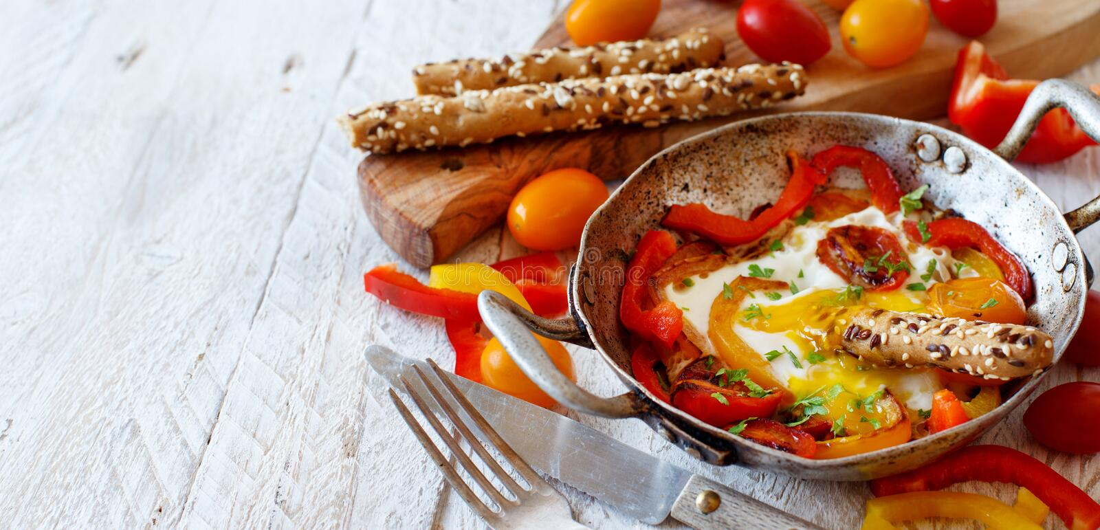 Fried egg with a bell pepper and tomatoes royalty free stock photography