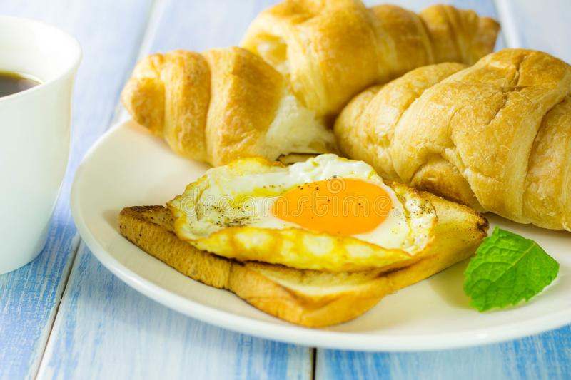Fried egg and bread placed on the table. And coffee stock images
