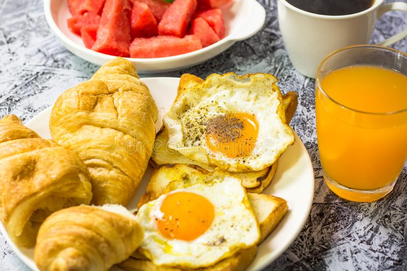Fried egg and bread on the table. And coffee stock photo