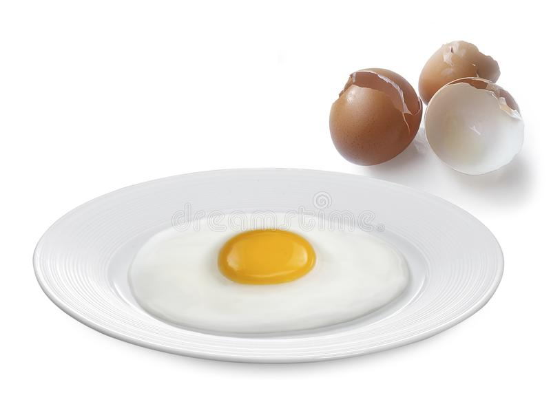 Fried egg and Eggs shell isolated on a white background stock image