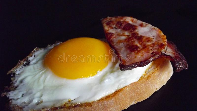 Fried egg. Fried egg and ham for Breakfast royalty free stock image