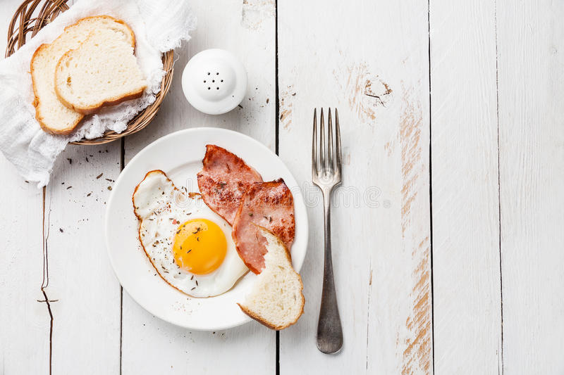 Fried egg. With grilled sausage for breakfast royalty free stock image