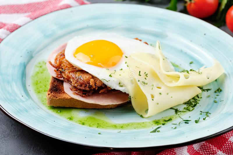 Fried Egg on Ham Sandwich Toast Bread Side View royalty free stock photos