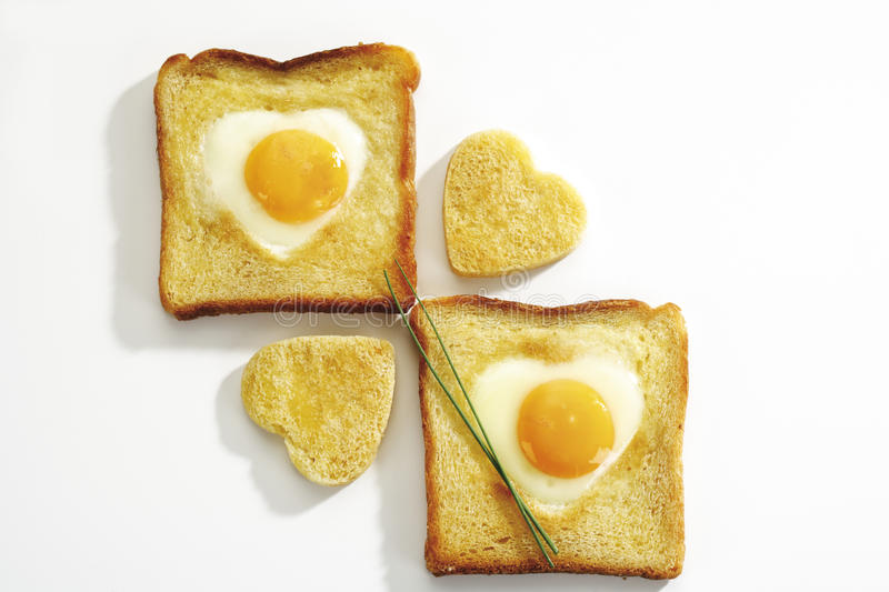 Fried egg (heart shape) in toast bread, elevated view royalty free stock image
