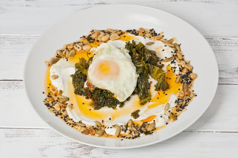 Fried Egg with Kale and Hot Chili Oil stock images