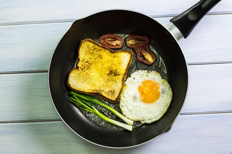 Fried egg in the pan placed on the table. Fried egg in the pan placed on floor white stock photo