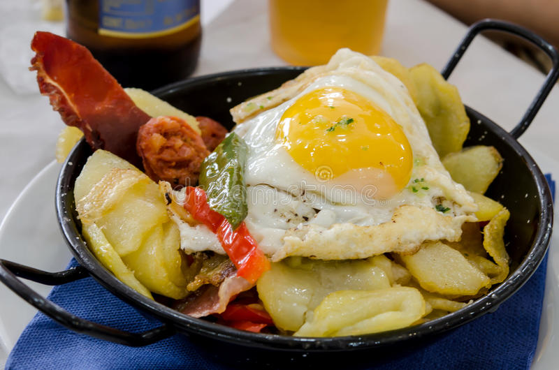 Fried egg. Pan with fried potatoes, fried egg, roasted peppers and sausage royalty free stock photos