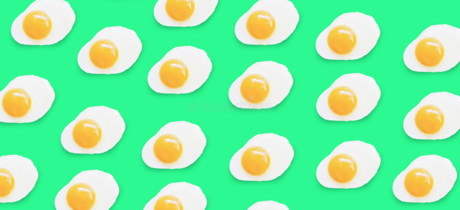 Fried egg pattern a colored background. Fried egg pattern on a colored background stock images