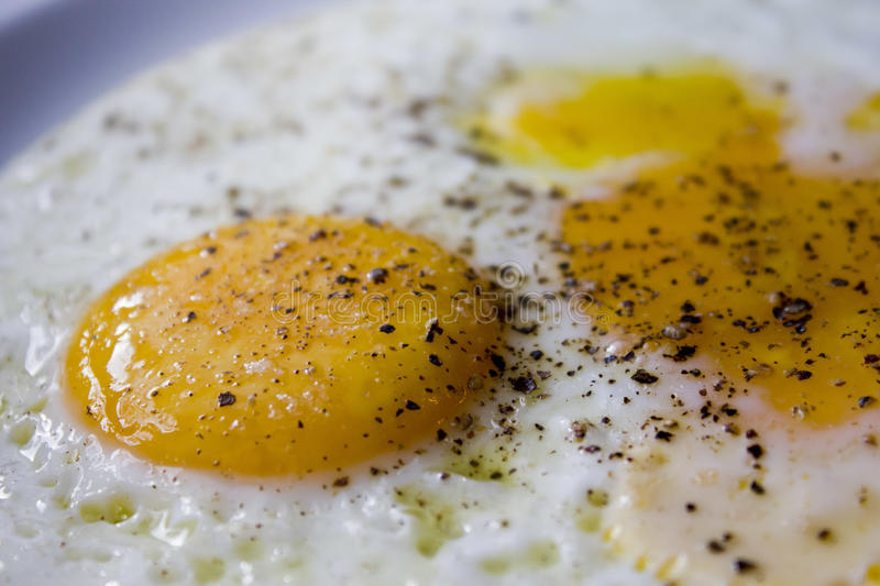 Fried egg with pepper royalty free stock images