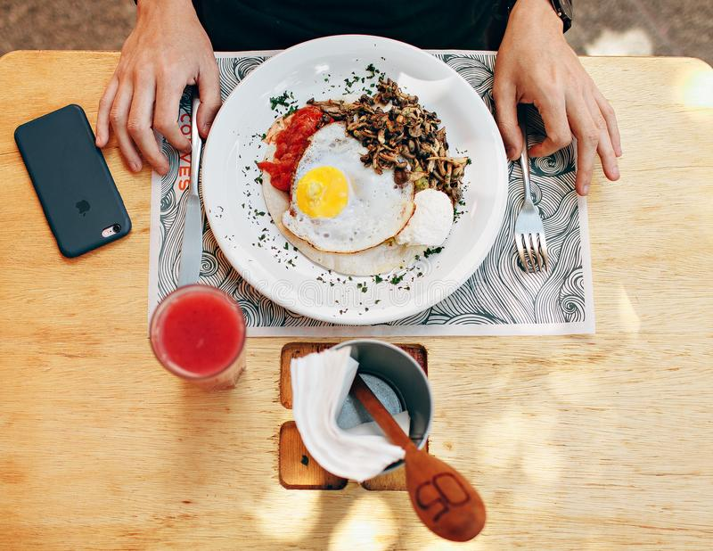 Fried Egg With Plain Rice on White Plate Beside Stainless Steel Fork With Clear Drinking Glass on Top Table royalty free stock photos