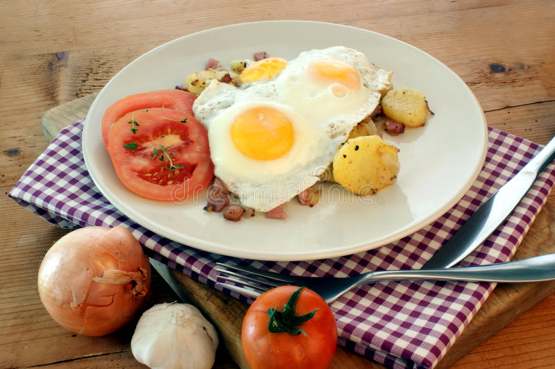 Fried Egg With Potato And Bacon Royalty Free Stock Images
